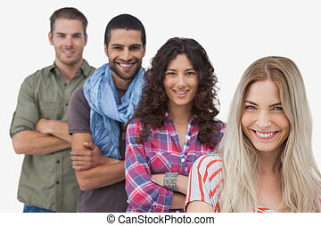 Fashionable friends looking at camera on white background