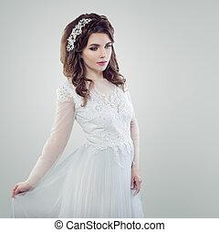 Fashionable girl beautiful bride portrait. Glamorous woman in white wedding dress
