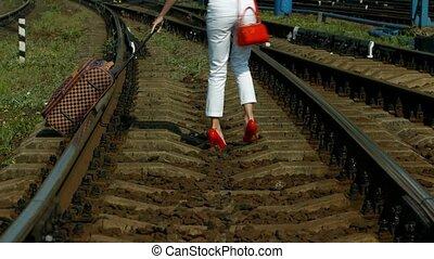 Fashionable girl. - Fashionable girl cross the railroad....