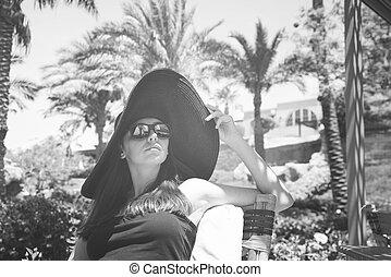 girl in the big black hat