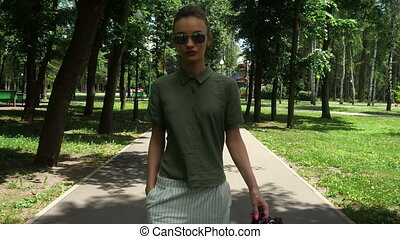 fashionable girl walks in the Park