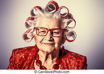 fashionable granny - Portrait of an elderly woman in curlers...