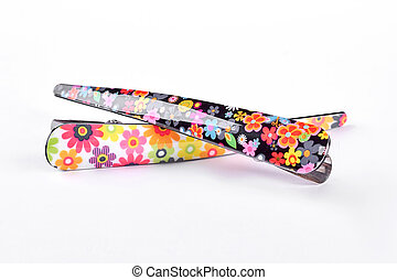 Fashionable hair clips on white background.