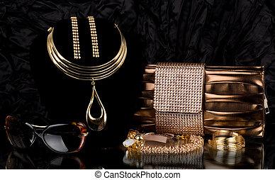 handbag and golden jewelry, glasses