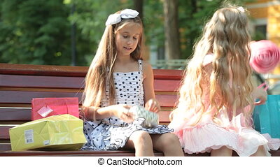 Fashionable little girls in summer dresses outdoor