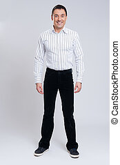 fashionable man full length over gray background