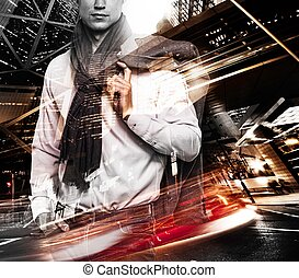 Fashionable man over modern city at night double exposure