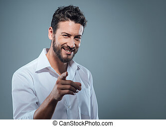 Fashionable man pointing at camera - Fashionable handsome...