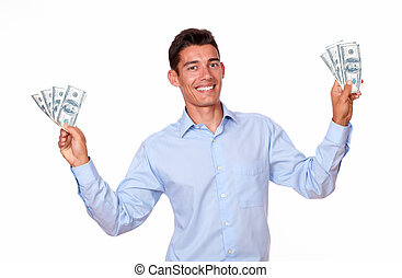 Fashionable man standing and holding cash