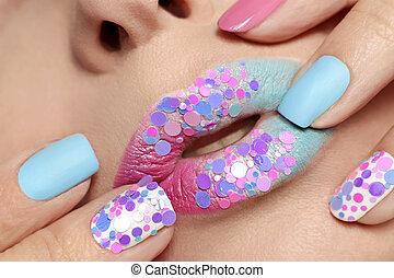 Fashionable manicure and lips.