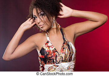 fashionable mulatto woman on red