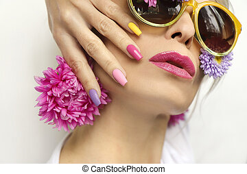 Fashionable multi-colored makeup and manicure
