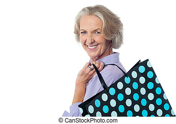 Fashionable old lady with shopping bag - Stylish old woman...