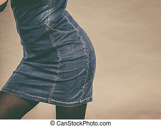 Attractive blonde woman wearing tight jeans dress