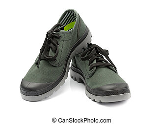 Fashionable pair of green sneakers. Isolate on white. -...