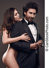 Fashionable portrait of elegant sexy couple in studio.
