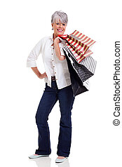 fashionable senior woman carrying shopping bags