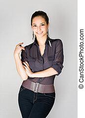 Fashionable slender brunette. - Portrait of a beautiful...