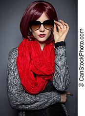 Fashionable Sunglasses - Woman in spring or fall fashion...