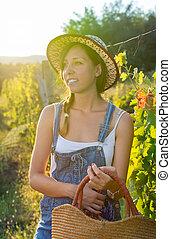 Fashionable woman at the vineyard