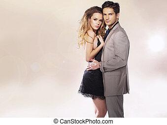Fashionable woman hugged by protective man - Fashionable...