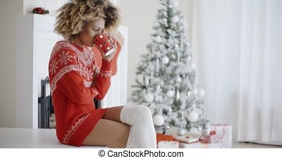 Fashionable woman in a festive Christmas outfit -...