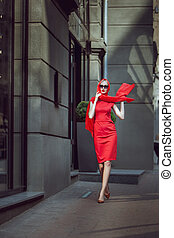 Fashionable woman in a red dress.