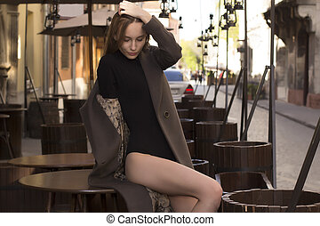 Fashionable woman in coat at the street