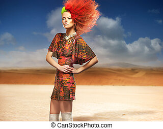 Fashionable woman in the desert