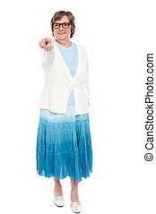 Fashionable woman pointing at you
