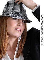 fashionable woman wearing a suit and a hat