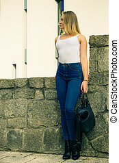 Fashionable woman with handbag