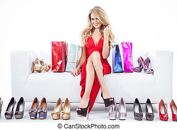 Fashionable woman with lots of shoes
