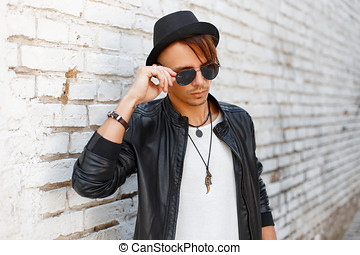 Businessman or young man wearing cowboy hat and black jacket ... 5c3fde3ec683