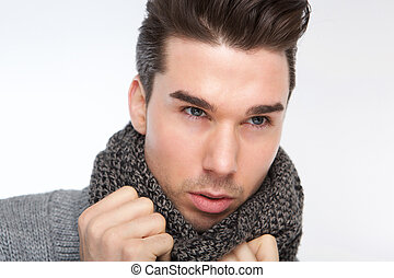 Fashionable young man posing with gray wool scarf