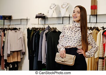 Fashionable young woman in a fashion showroom