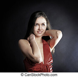 fashionable young woman in red dress looking at copy space. iso