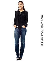 Fashionable young woman posing casually