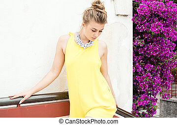 Fashionable young woman posing outdoor.