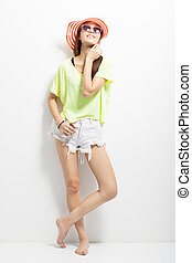 fashionable young woman standing on a white background