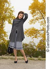 Fashionable young woman with bag