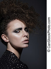 Fashionable Young Woman with Stylish Hairdo
