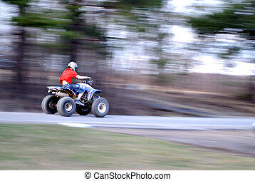 Fast 4 wheeler - A youngster breaks the law as he rides the...