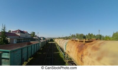 Fast and maneuverable flight along freight carriages. Filmed...