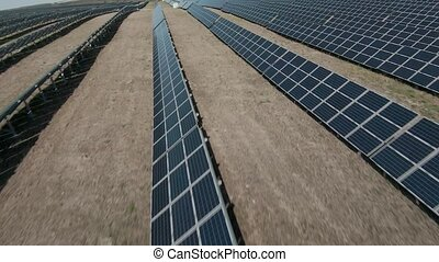 Fast and maneuverable flight over a field of solar panels. Ecological innovation. Future concept