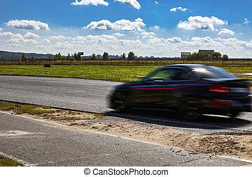 Fast black car