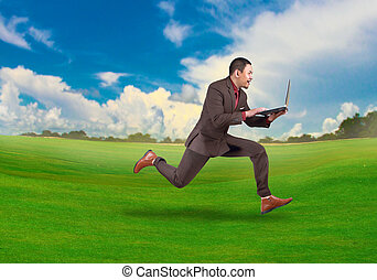 Fast Businessman Running While Carrying Laptop