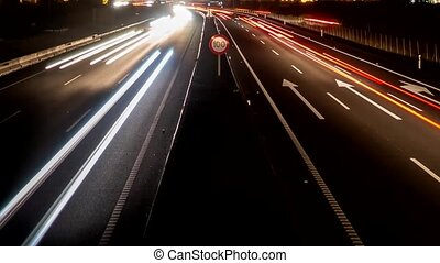 Fast car lights in the highway, loop-ready time lapse -...