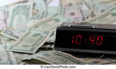 Fast Clock with Still Money - A red numbered digital clock...