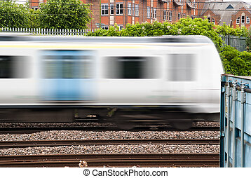Fast commuter train passing by during rush hour